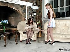 Hottie in high heel shoes seducing cute gal into nylon clit-to-clit action