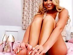 Blonde Natalia enjoying some sexy foot fun on the bed!