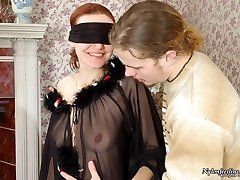 Blindfold cutie getting her delicious feet clad in black pantyhose stroked
