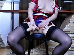Hot maid in a red uniform and black FF nylons pleasuring her itching pussy