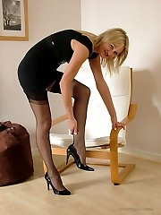 Gorgeous blonde Caroline attaches her suspender belt to her sexy nylons, and then cant resist a...