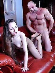 Pretty girl gets her nyloned feet creamed after a bout of kinky foot sex