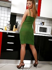 Glamour babe with yummy nyloned feet gets into playful mood in the kitchen