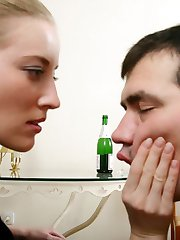 Young bear takes his domina�s hose off with his teeth and gets down to licking her smelly feet