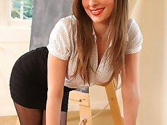 Leggy Danielle in short skirt and pantyhose