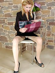 Blonde business lady in shiny elegant pantyhose diddling her yummy pussy
