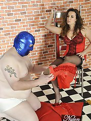 Hot Milf Nylon Jane uses gimp as a foot stool as he helps her into a sexy pair of red thigh high...