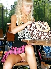 Nude upskirt view from lusty doll sitting with spread legs