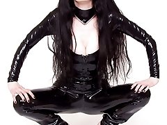 girl in catsuit and high heels strips and spreads