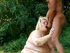 Blonde fatty Amanda flashes her round ass outdoors and gets fucked by a black hunk
