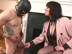 The Majestic Queen herself Maitresse Madeline Marlowe is back at work training her pathetic slaves. Today Reed Jameson has been tied up and thrown in the bathtub to wait for his Queen. This sad excuse for a man has his face covered and his mouth gagged. His body is restricted in tight rope bondage. His balls are flattened in a brutal vice. He is ready to taste and devour this beautiful goddess' body, but is he worthy. Can he take the divine corporal punishment, will this pain and torment bring him rewards? Maybe just a taste. Madeline smothers his face in her breasts while she squeezes his balls even tighter and flatter in a vice grip. She gives his little rock hard cock a treat with the flick of her tongue. She allows reed to lick her perfect pussy until she cums all over his miserable face. Of course her feet need worshipping too! Reed licks her high heels and stockings clean before Madeline straps on a huge black dildo. She rides him with deep strap on fucking. Proving his worth he is allowed to cum all over himself in front of the Queen Femme Daddy.