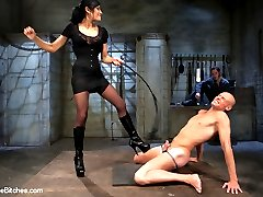Beretta James is as evil as can be in this reality cuckold update! She's so eager to cuckold Sean that she starts humiliating him in the greenroom before we even start shooting! What little that Sean has left of his ego is completely destroyed once Beretta's bull demands Sean wear a pair of panties down to the dungeon and get ready to be cuckolded. Beretta dominates Sean whipping him with a nasty stingy cat o' nine tails. He's humiliated in front of another man made to jerk off in front of them while she sucks her bulls cock and spits it on to Sean. He is even pounded deep in his ass with a strap-on while Beretta commands him to suck her bulls cock getting it ready for her to fuck. Funny thing about certain cuckolds though is that sometimes in the middle of the humiliation they start to like it. We discover Sean's secret because his cock can't lie when it erupts with filthy cuck juice while getting pounded and sucking cock. His dick is placed directly into chastity so he can suffer while watching his mistress fuck and have the orgasms she wants and he so desperately wishes he was capable of giving to her.