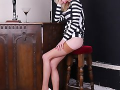 Gorgeous leggy blonde Emma shows off her amazing long legs encased in silky nylon stockings with...
