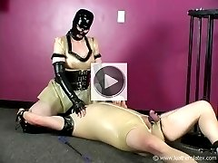Latex domme facesitting and smothering her latex slave