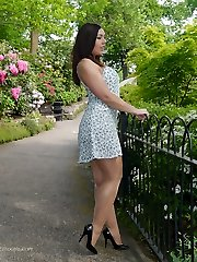 Brunette babe Lauryn teasing in the park in a pair of fully fashioned nylons and black stilettos