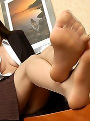 Voluptuous secretary in silky pantyhose tenderly tickling her nyloned feet