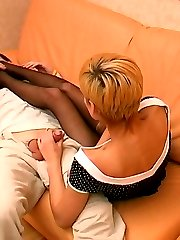 Sexy blondie in black hose giving frantic footjob and breathtaking blowjob