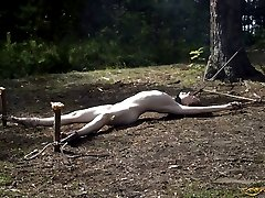 Girl crucified and left alone in the wood
