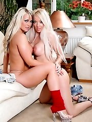 Two naughty lesbian babes playing on the couch
