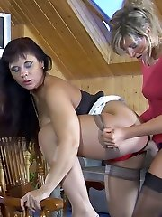 The girl in the pink dress has her mature lover bent over and she is fucking her pussy hard...