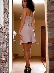 Elegant lady strips to her tan sheer-to-waist pantyhose and black stilettos