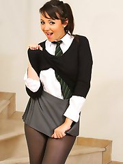 Rachael looks delightful as she teases her way out of sexy college uniform