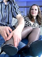 Frisky brunette gives a nylon footjob making her guy hard and ready for her