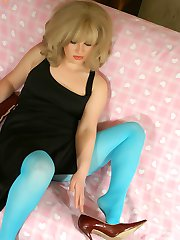 Blonde MILF masturbates in blue pantyhose and cums