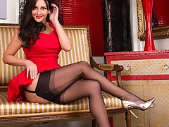 Sitting coyly in her full frock, Cassie begins to strip, showing her hour glass figure her...