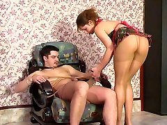 Kinky babe in control top pantyhose massaging a rocky cock through tights