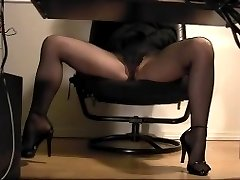 Hidden cam peeps a secretary masturbating in her pantyhose