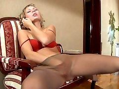 Heated girl strips to her silky hose and rubs her pink talking on the phone