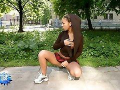 Nice shots of a sweet teen getting nude in public