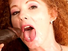 Annie Body has her hairy red hole filled with some dark meat!