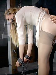 """Emma Haize is a hot blonde, sporting a pair of tits that scream """"touch me"""", a pretty little pussy begging to be fucked, and a love of bondage that speaks for itself. She doesn't hesitate for a second when it comes to getting down and dirty with the masters of BDSM. O.T. is her guide today, into the world of seductive bondage, rough corporal punishment, and intense sexual humiliation."""