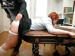 Bent over in pain for a brutal caning