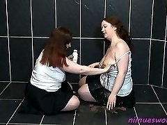 Nimue plays in a messy way with Rosie taking turns to lick chocolate sauce off each other...