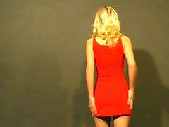Natural blonde giving strip tease