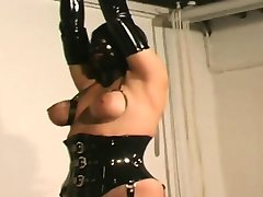 Chick in latex bonded big tits maledom torture
