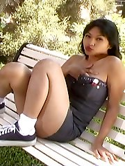 Sexy young Asian pornstar Mika Tan gets naughty on a bench