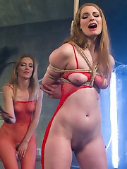 Sexy mad scientist Mona Wales clones herself, creating a horny submissive sex toy Ela Darling to...