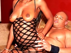 Sexy ebony Lady Armani gets big cock stuffing in her mouth and rides on top of it to take it in...