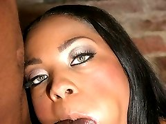 Sultry ebony with a sweet face Dream stripping off her clothes and stuffing her mouth with a...