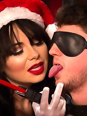 Mistress Siouxsie Q James celebrates the holidays training Divine Bitches newest young slave,...