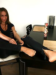 Leggy chick shows off her painted toe nails thru her ultra sheer pantyhose