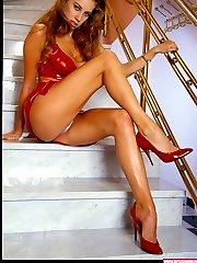 Leggy babe Kristina in red high heels