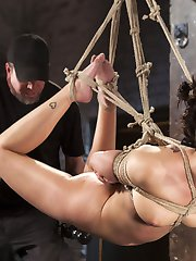 Ava finds herself tied with her hands above her head and her legs spread wide. Her all natural body is amazing and I plan to enjoy and torment every inch of it. This whore quickly shows her true colors and the slut in her comes out. Every bit of pain drives her as back wanting to get fucked. Next we have her in a strenuous hogtie and tethered to a point above. Her helpless body is tormented and then we lift this slut in the air. She's now hanging from only two points and it's taking it's toll on her. Her pussy is fucked and she is made to cum, which distracts her from the pain temporarily.We start the nest scene with her in an inverted single point suspension. The suffering is immediate from the grueling tie. Her sensitive soles are brutalized until she can't take it any more. The tie transforms into a more sustainable position, and then she is fucked into more orgasms.In the final position, we have her helpless on her back with her legs spread as wide as they will go. Her pussy is my target for this one, starting with some flogging to get her cunt overly sensitive. Then her cunt and mouth are fucked and she is made to cum until she can no longer take it.