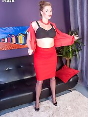 Holly dressed in black full fashion nylons, matching heels and dressed in racy red snug fitting blouse and skirt.