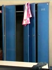 Slim young doll disrobes in a big locker room