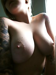 Inked honeys flaunt their breasts and ass